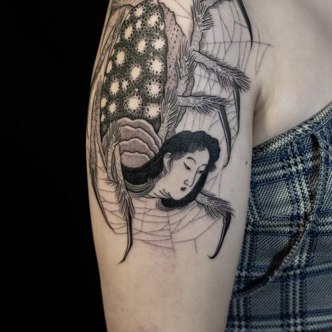 Black work spide tattoo