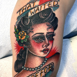 Female portrait tattoo