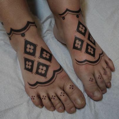 Pattern work tattoo on feet