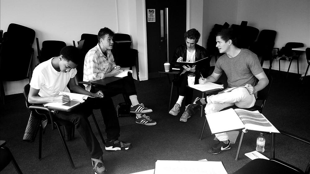 boys rehearsing sitting.jpg