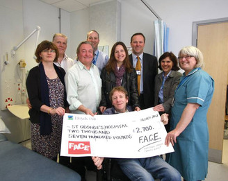 Gareth presents cheque to St George's hospital