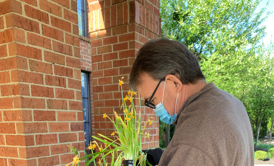 Donald Bowling Planting Flowers