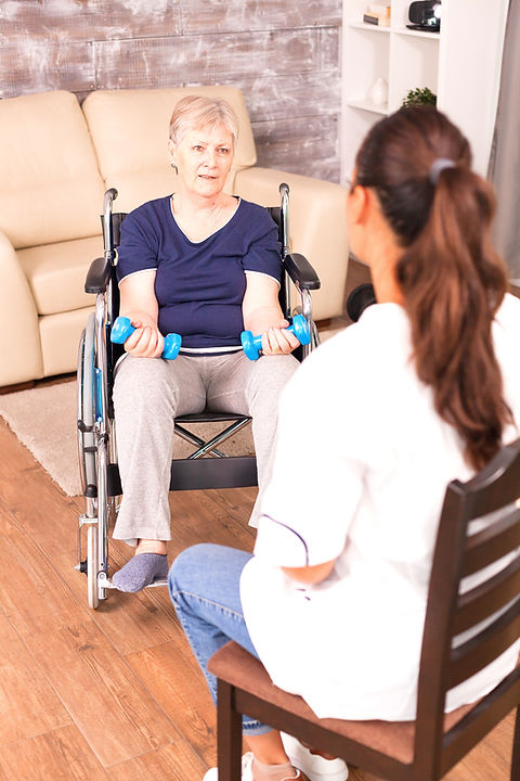 woman-in-wheelchair-discussing-with-nurs
