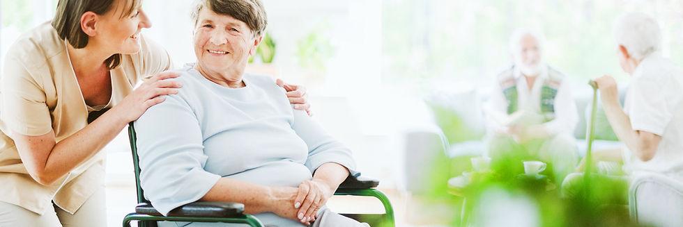 happy-caregiver-with-elder-patient-on-th