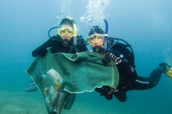 Divers with mesh bag
