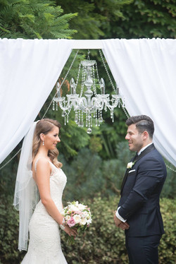 Glam Arch With A Crystal Chandelier