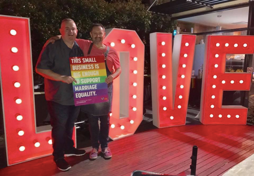 Mark and Dave from Cafe Bear and Scoobs, infront of Dream Ceremony Decor's giant Love Light Letters