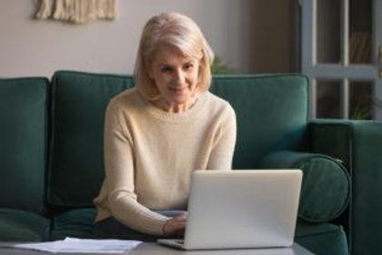 older-lady-sofa-laptop.jpg