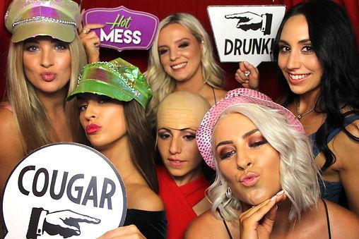6 girl in a photobooth