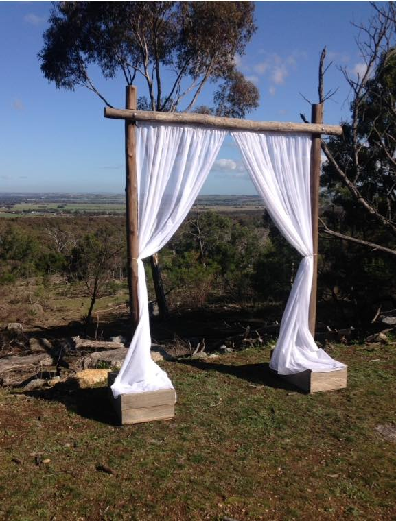 Rustic Arch With Sheer Curtain