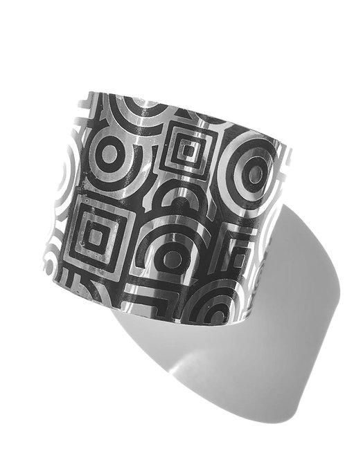 square peg round hole black & silver steel cuff bracelet