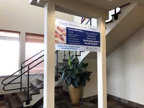 Acrylic Mounted Sign Between Columns