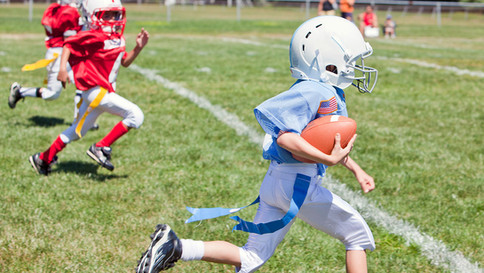 boy-running-flag-football.jpg
