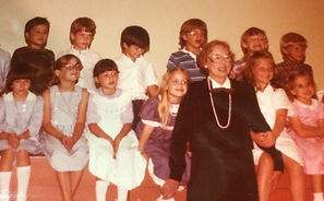 Lynn Flowers with kids.jpg