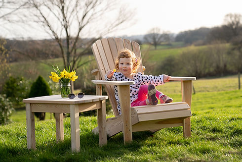 Child sitting on Adirondack Chair
