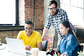 creative-business-team-using-computer-in