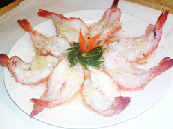 60. King Prawns in shell with garlic