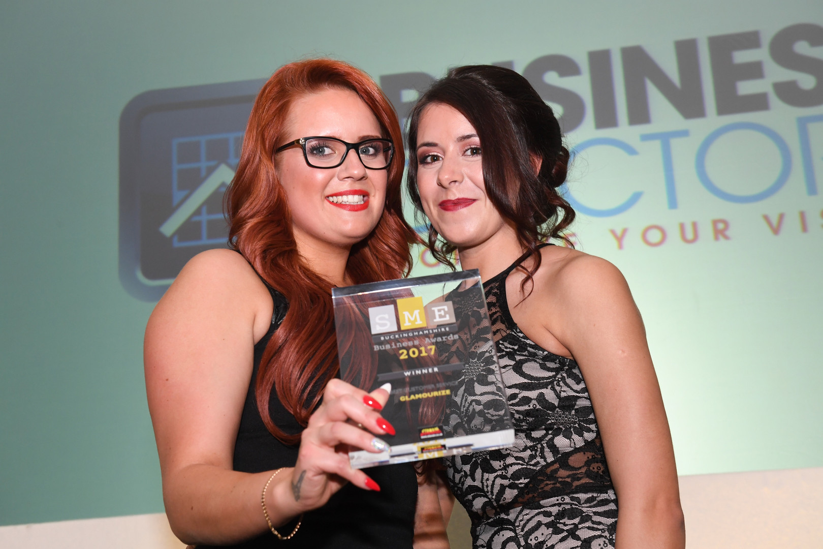 Zoe and Rheannon collecting Best customer service award