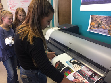 Naomi catching the prints from the printer