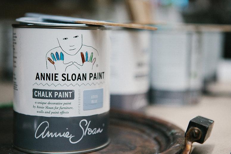 Annie Sloan Chalk Paint liters and paint stir sticks.