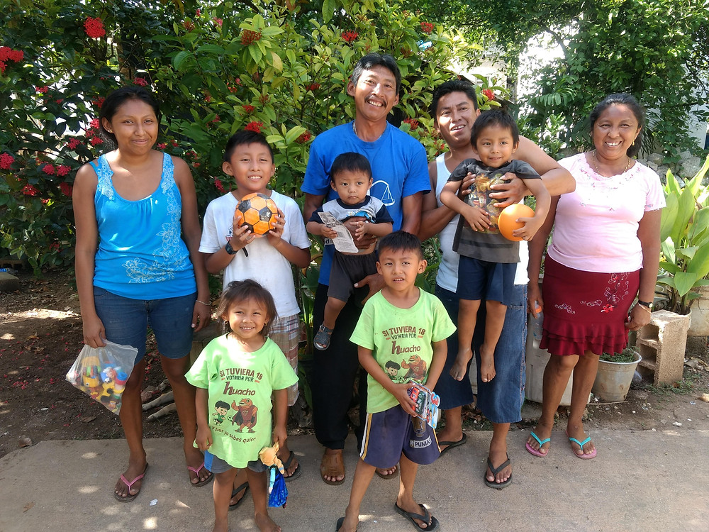The tallest man who is wearing the blue shirt is Francisco, the herbatero. The guy with the white shirt is the smiley Maya guy. The lady in the maroon skirt is Francisco's wife and herbatero assistant, the lady in the blue shirt is somebody's sister, and the kids are super cute!