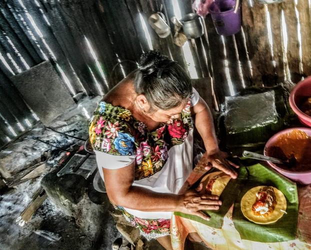 cooking ceremonial tamales