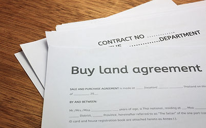 land contract form on wood background..j