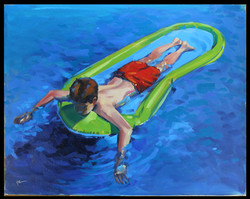 Boy Relaxing on Raft