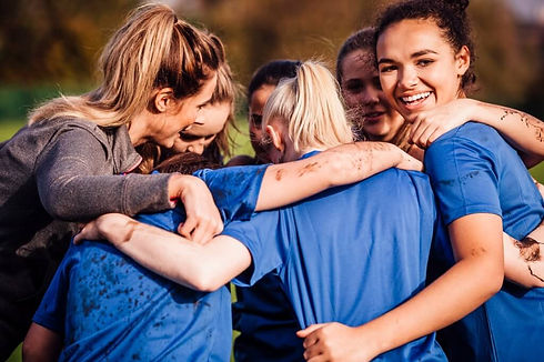 female-rugby-players-together-in-a-huddle-picture-id648944056 (1) (1).jpg
