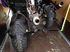Motorcycles strapped down in van for transport