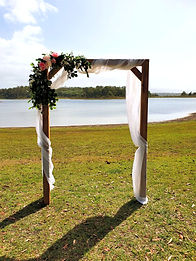 Single wooden arbour with florals and draping