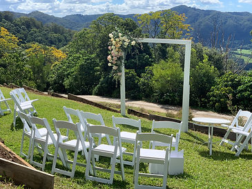 White wooden wedding arbour