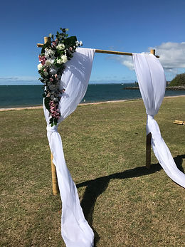 Single bamboo arbour with florals and draping