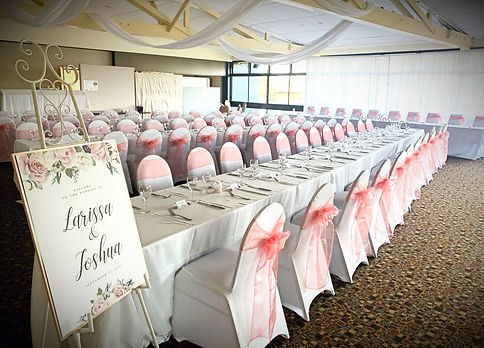 Long wedding tables, easel, chairs