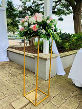 Gold floral stand with florals