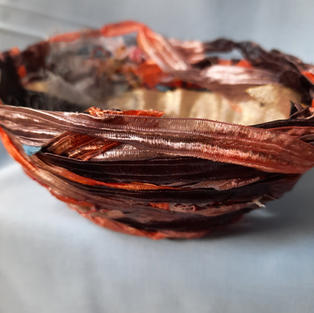 Fabric and threads from other projects moulded into artful bowls and trinket dishes. Various sizes.