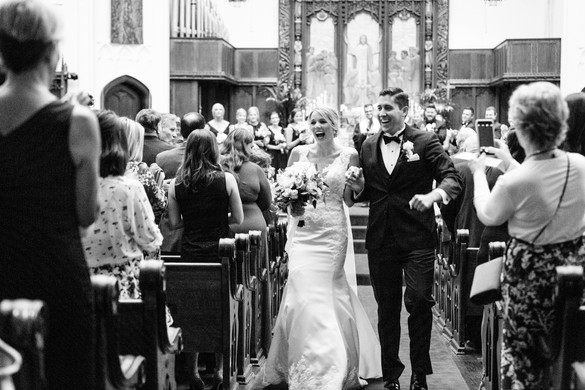 bride and groom walking down the aisle