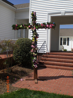 The Living Cross made with flowers brought to church by the members.