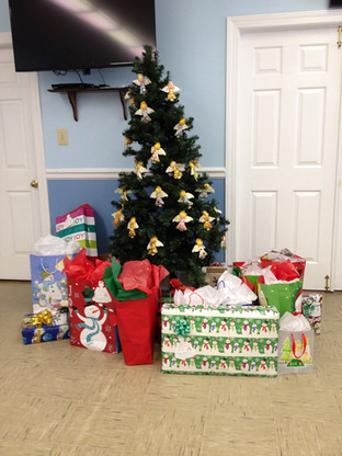 Gifts being prepared for children under the angle tree.
