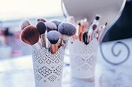 Makeup brushes in pots.jpg