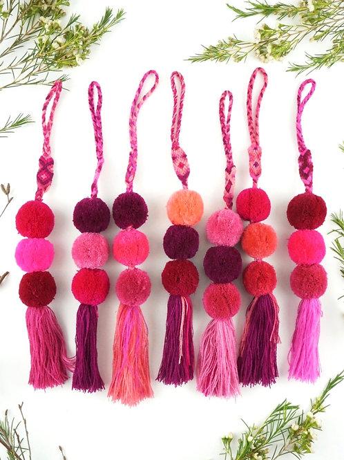 Pink pompoms tassel