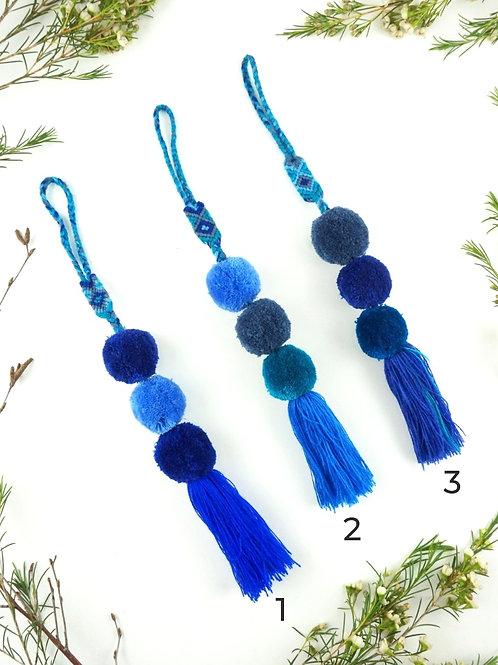 Blue pompoms tassel