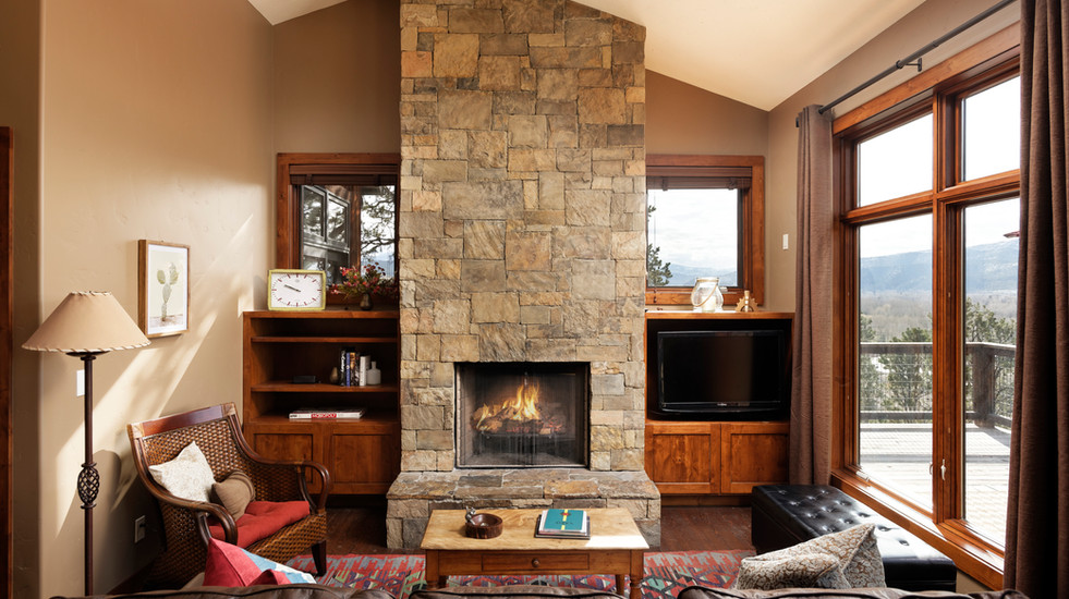 Enjoy a roaring fire as you look out at the expansive valley below.