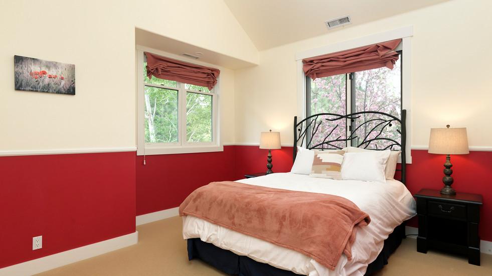 Upstairs queen-sized guest bedroom