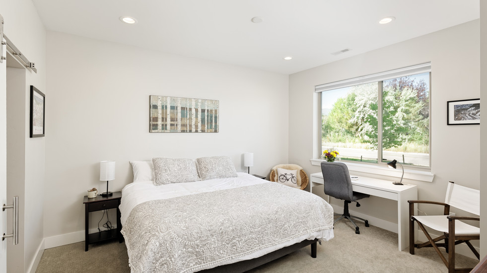 Bright and airy master bedroom with desk
