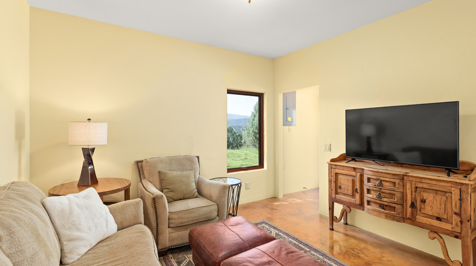 Downstairs additional den with smart TV and lounge seating