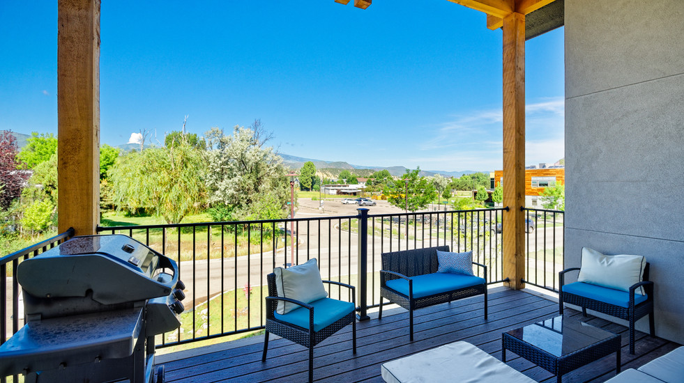Carbondale views await on the spacious porch with grill and seating.