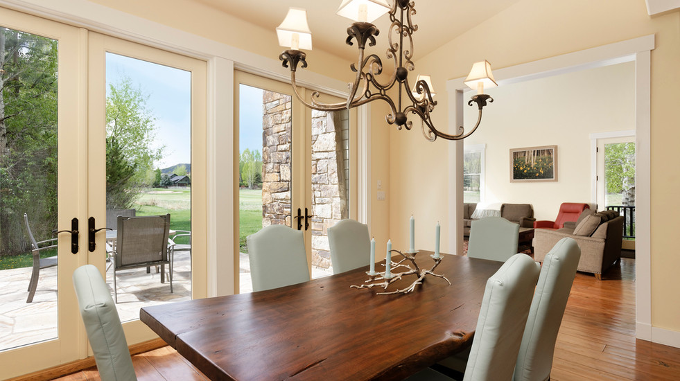 Dining room with French doors that open up to the patio.