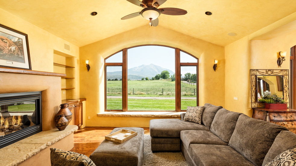Living room with views of the surrounding pasture and Mount Sopris
