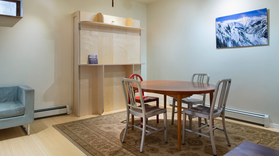 New queen-sized Murphy bed that can be accessed by moving the dining table
